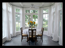 A conservatory addition in Louisa County, Virginia, with bluestone floor and coffered ceiling, in Louisa County, Virginia, by Candace M.P. Smith Architect
