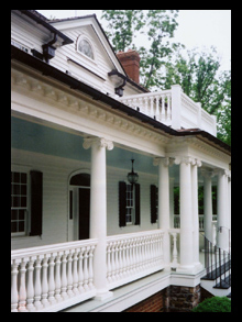New residence with custom front porch with ionic columns, wood balustrade and copper gutters for house at the Greenbrier, West Virginia, designed by Candace M.P. Smith Architect